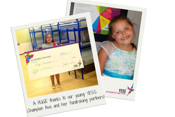 Young YESS Champion Ava presenting her donation
