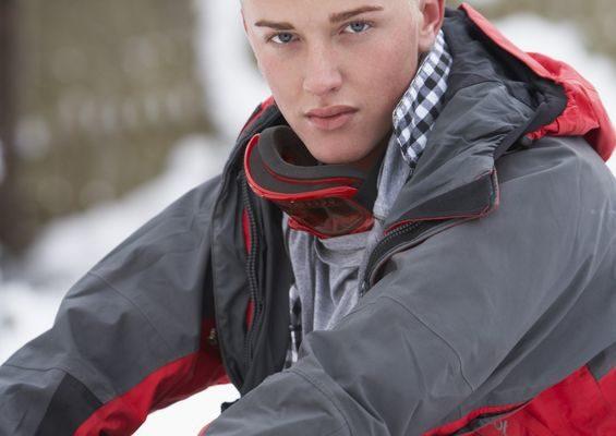 Youth wearing parka, outside in winter