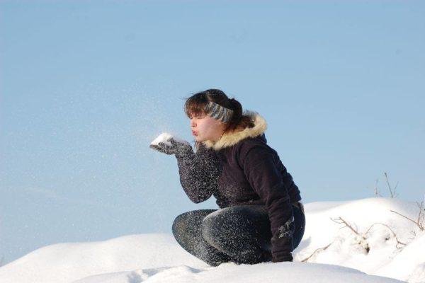 Youth making snowballs