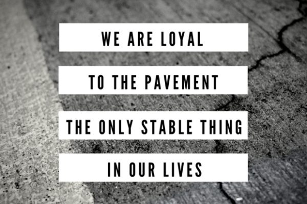 """We are loyal to the pavement"" stamped on concrete"