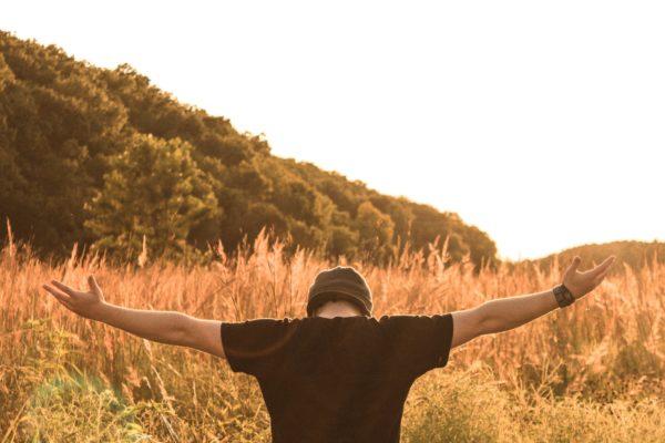 Young man facing the sun