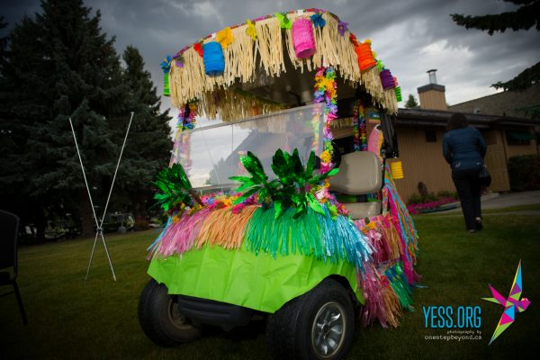 Luau-themed golf cart at the YESS Golf Classic